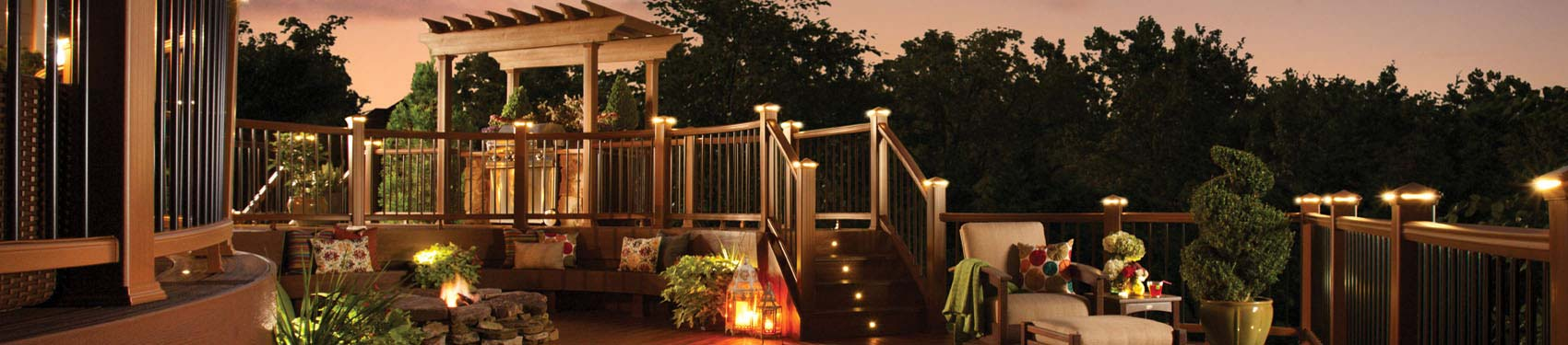 Outdoor living area featuring brown trex decking at sunset